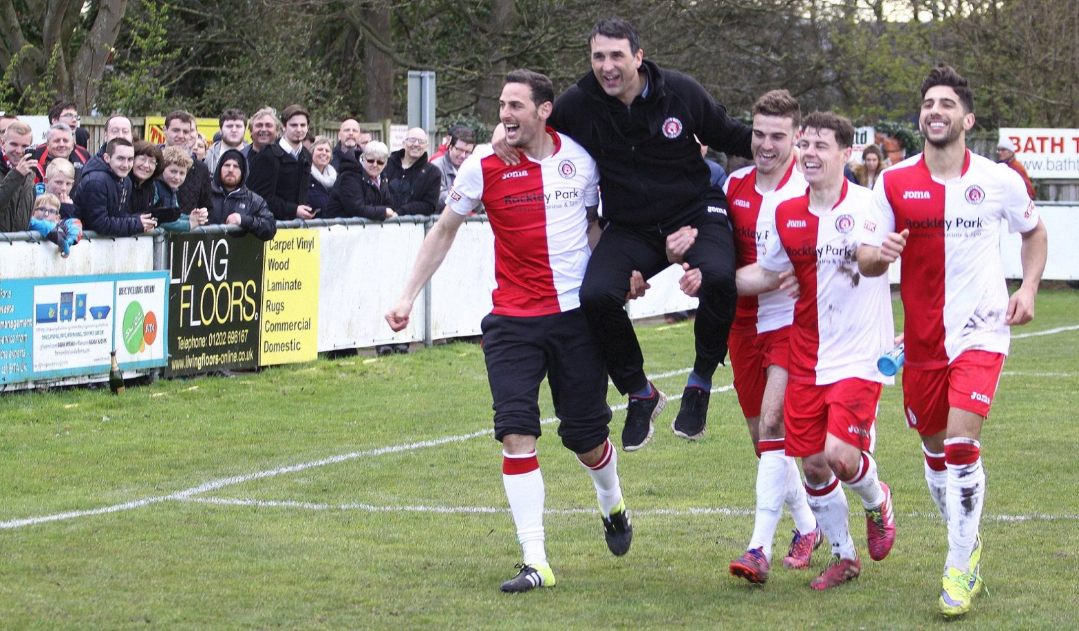 Killick carried by his charges (Photo Credit: Andy Orman)